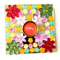 Artificial Rangoli and Diya having flower design
