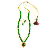 Necklace with pendant using green color beads